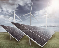 Solar panels with wind turbines stock image