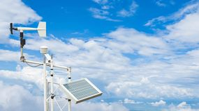 Solar panels with wind turbines against cloudy sky. concept clea Stock Images