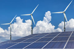 Solar panels and wind turbines alternative energy Stock Photo