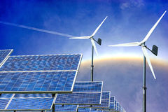 Solar panels and wind turbines alternative energy from nature. On sun halo background Stock Photography