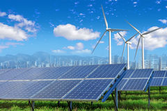 Solar panels and wind turbines with city Royalty Free Stock Image