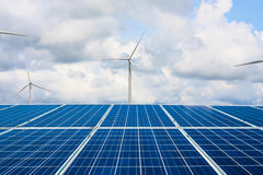 Solar panels and wind turbines with the clouds and sky Royalty Free Stock Photo