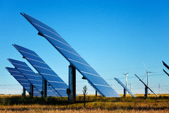 Solar Panels and Wind Turbines royalty free stock photography