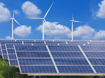 Solar panels and wind turbines generating electricity in power station Stock Image