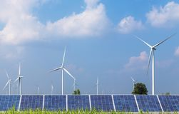 Solar panels and wind turbines in hybrid power plant systems station Royalty Free Stock Photography