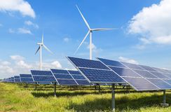 Solar panels and wind turbines in hybrid power plant systems station. Solar panels and wind turbines generating electricity is solar energy and wind energy in stock image