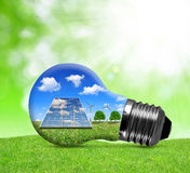 Solar panels and wind turbines in light bulb. Royalty Free Stock Photo