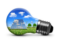 Solar panels and wind turbines in light bulb. Isolated Stock Photography