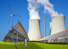 Solar panels, wind turbines and nuclear power plant. Royalty Free Stock Photos
