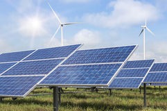 Solar panels and wind turbines in power station Royalty Free Stock Photo