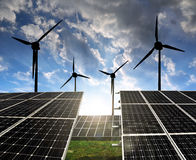 Solar panels with wind turbines Stock Photography