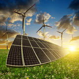 Solar panels with wind turbines Stock Photos