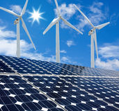 Solar panels and Wind Turbines sunny day Royalty Free Stock Photo