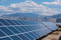 Solar panels and wind turbines in sunny desert Royalty Free Stock Photos