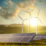 Solar panels and wind turbines Stock Photos