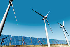 Solar panels and Wind Turbines under blue sky 3D Royalty Free Stock Image