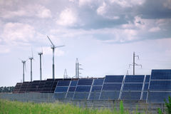 Solar panels and windmill Royalty Free Stock Images