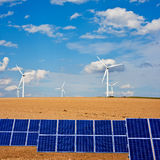 Solar panels and windmills on Autumn field Stock Photos