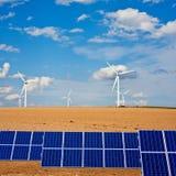Solar panels and windmills on Autumn field Stock Photos