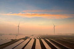 Solar panels. And windmills in the power plant royalty free stock image