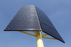 Solar panels on yellow metal stand and blue sky Stock Photo