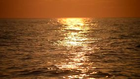Solar path light on the waves of the sea during sunset, sunrise