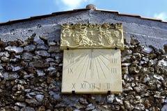 Solar pendulum fixed on a building wall stock photo