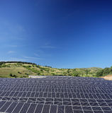 Solar photovoltaic cell panels on field under blue sky at Macedo Stock Photos