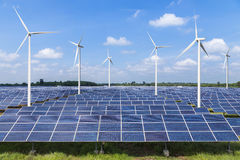 Solar photovoltaics panel and wind turbines generating electricity. In solar power station royalty free stock photos