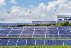 Solar photovoltaics panel and wind turbines generating electricity. In solar power station stock image