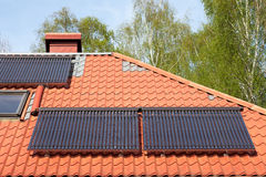 Solar pipes on roof royalty free stock photo