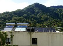 Solar Planes on Top of House in Hong Kong. Solar Planes on Top of House in Kadoorie Farm and Botanic Garden in Hong Kong in China. This is an educational park stock photo