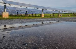 Solar Plant reflect on the water after rain.  Stock Photo