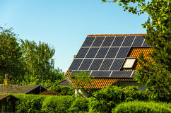 Solar Pnaels and realistic enviroment. With some trees in foreground and background Stock Photo