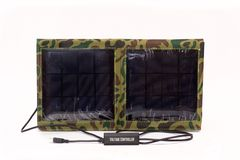 Solar. Portable Solar charger for mobile phones and notebook  on white background Royalty Free Stock Photo