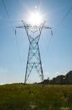Solar power. Sun burst and power lines Stock Photo