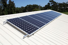 Solar power. A residential roof top solar panel system Royalty Free Stock Photo