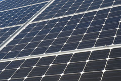 Solar Power. Solar Panel grouped together in bright sun Stock Image