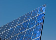 Solar Power. Blue solar cells on a blue sky background Stock Images