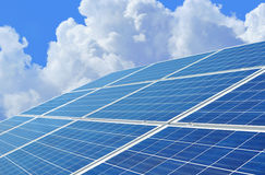 Solar power for electric renewable energy from sun. Blue solar panels converting energy from the sun into usable electricity stock photos
