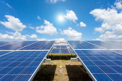 Solar power for electric renewable energy from the sun. Solar panel with blue sky Royalty Free Stock Photo