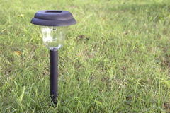 Solar power garden light Stock Photos