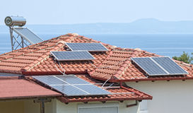 Solar Power. And hot water on a house Royalty Free Stock Image