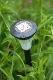 Solar power lantern outdoor in grass closeup Stock Photos