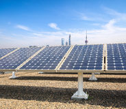Solar power with modern city background Stock Image