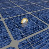Solar power. One Euro coin is saved with solar power Royalty Free Stock Images