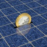 Solar power. One Euro coin is saved with solar power Stock Photos