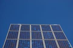 Solar power panel. A solar power panel with a blue sky Stock Photos
