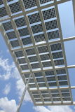 Solar power - Panels against Blue sky. Solar power panels structure - Bottom up picture Royalty Free Stock Photos