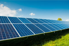 Solar power panels on blue sky and copy space Stock Photos